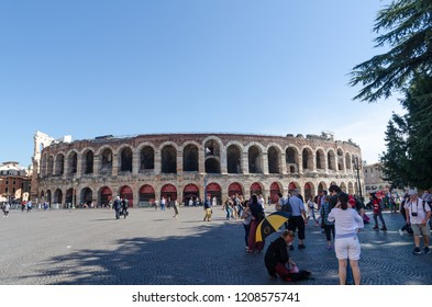 Verona, Italy - October 5, 2018: Tourists in front of the ancient arena at Piazza Bra in Verona in Italy