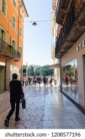 Verona, Italy - October 5, 2018: Heading for the crowded Piazza Bra downtown in the city of Verona in Italy