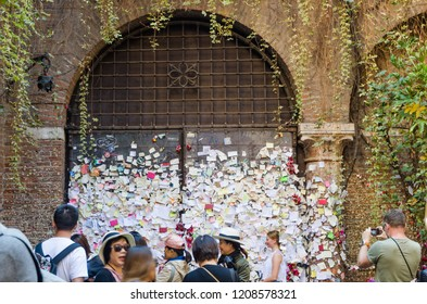 Verona, Italy - October 5, 2018: Tourists by the notes at the Romeo and Juliet balcony in the city of Verona in Italy