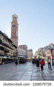 Verona, Italy - October 5, 2018: View at the Lamberti tower from Piazza Erbe in Verona in Italy