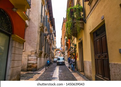 Verona, Italy, on April 24, 2019. the picturesque narrow street with a traditional architectural complex in the old city.