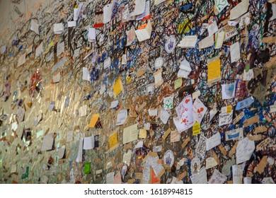 Verona, Italy - September 10, 2019: Love notes stuck on the walls of the Casa di Giulietta