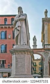 VERONA, ITALY - SEPTEMBER 11, 2018: Photo of Monument to the poet Dante Alighieri (Monumento di Dante). Signoria Square.