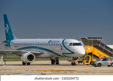 VERONA, ITALY - SEPTEMBER 2018: Air Dolomiti Embraer E195 short haul passenger jet at Verona airport.