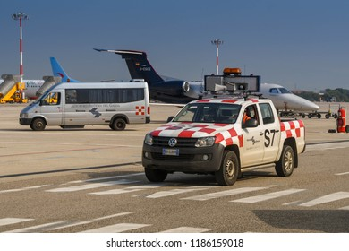 VERONA, ITALY - SEPTEMBER 2018: Airport marshalling vehicle painted in red chequered markings at Verona.