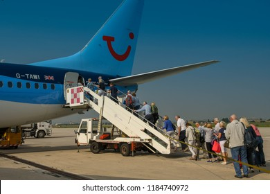 VERONA, ITALY - SEPTEMBER 2018: Passengers queuing to board a TUI Boeing 737 at Verona airport at the end of their holiday.