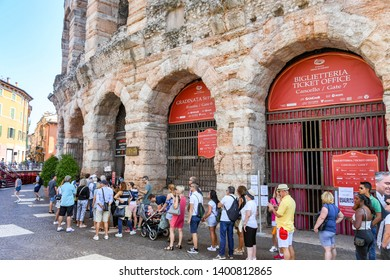 VERONA, ITALY - SEPTEMBER 2018: People queuing for tickets for the Verona Arena. It is a Roman amphitheatre in the city centre and is used for classical concerts.