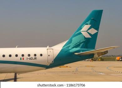 VERONA, ITALY - SEPTEMBER 2018: Tail fin of an Air Dolomiti Embraer 195 airliner at Verona airport.