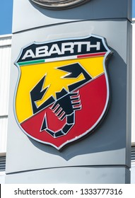 Verona, Italy - September 4, 2018: Abarth car dealership. Abarth SpA is a racing car and road car maker. Its logo is a shield with a scorpion on red and yellow background