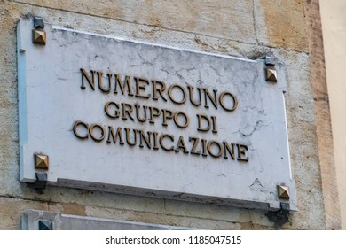 Verona, Italy - September 5, 2018: Marble plaque with the text ´Numerouno Gruppo di Comunicazione´ (Italian for: Number one, Communication group)