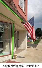 VERONA, NEW JERSEY - AUGUST 3, 2017: American flag outside of NJ Kitchens and Baths at 380 Bloomfield Avenue in Verona. Editorial use only.