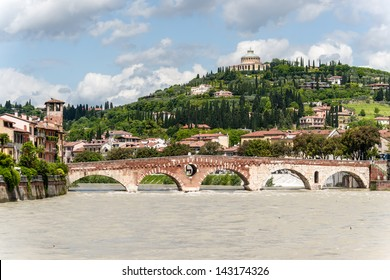 Verona, northern Italy. View of city and river in evening sunlight