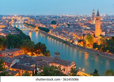 Verona skyline with river Adige, bridges, Santa Anastasia Church and Torre dei Lamberti or Lamberti Tower at evening, view from Piazzale Castel San Pietro, Italy