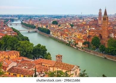 Verona skyline with river Adige, Santa Anastasia Church and Torre dei Lamberti or Lamberti Tower at evening, view from Piazzale Castel San Pietro, Italy