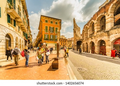 VERONA (VR), ITALY - MAY 10, 2019: tourists walking in Piazza Bra, square of the Arena in historical center of Verona, city of lovers