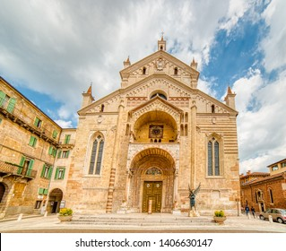 VERONA (VR), ITALY - MAY 10, 2019: tourists walking along Roman Cathedral Santa Maria Matricolare dedicated to the Blessed Virgin Mary in Verona