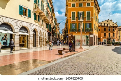 VERONA (VR), ITALY - MAY 10, 2019: tourists having fun and walking in Piazza Bra, square of the Arena in historical center of Verona, city of lovers
