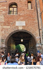 Verona,Veneto/Italy-July 18 2018:A view of the crowded entrance to Juliet's House in Verona the city of the most famous lovers in history: Romeo and Juliet