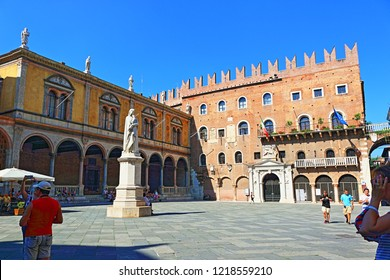 Verona,Veneto/Italy-July 18 2018:Piazza dei Signori surrounded by notable buildings, this public square features a statue of Dante Alighieri & cafes.Verona,Northern Italy