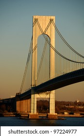The Verrazano-Narrows Bridge connecting Staten Island and Brooklyn in New York City as seen at sunset from Fort Wadsworth on Staten Island.