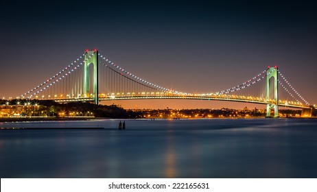 Verrazano-Narrows Bridge at night, as viewed from Ocean Breeze Fishing Pier, in Staten Island, New York