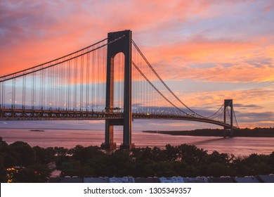 Verrazzano-Narrows bridge in Brooklyn and Staten Island, NYC at sunset with colorful sky