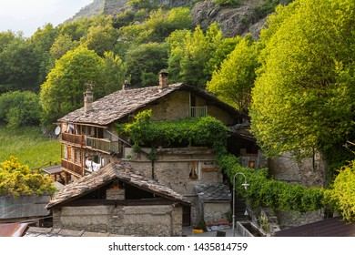 Verres, Aosta Valley, Italy - April 30, 2007: Mountain house with flagstone roof at the foot of the castle of Verres.