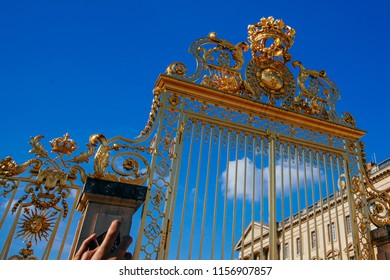 Versailles chateau. France. View of golden gate to palace. Royal residence near Paris. King's quarters. Famous touristic renaissance architecture landmark in summe