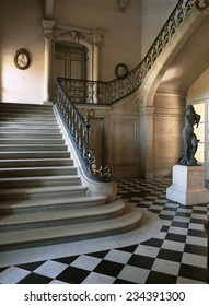 Versailles, France - 10 August 2014 : Marble staircase at Versailles Palace ( Chateau de Versailles ). It was added to the UNESCO list of World Heritage Sites.