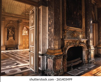 Versailles, France - 10 August 2014 : Room with wood floor and fireplace at Versailles Palace ( Chateau de Versailles ). It was added to the UNESCO list of World Heritage Sites.