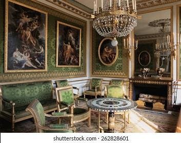 Versailles, France - 10 August 2014 : Green room with furnitures and paintings at Versailles Palace ( Chateau de Versailles ). It was added to the UNESCO list of World Heritage Sites.