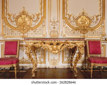 Versailles, France - 10 August 2014 : Wood wall with gold ornaments at Versailles Palace ( Chateau de Versailles ). It was added to the UNESCO list of World Heritage Sites.