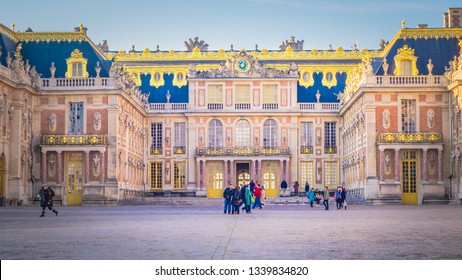 Versailles / France - 12 16 2016: Famous palace Versailles with beautiful outdoor gardens. The Palace Versailles was a royal chateau that was added to the UNESCO, the World Heritage Sites.