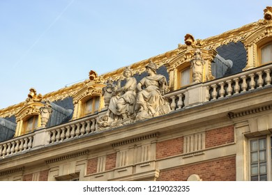 VERSAILLES, FRANCE -23 OCTOBER 2018 : Gilded facade with sculptures of the Palace of Versailles. Versailles, France.