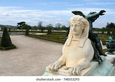 VERSAILLES, FRANCE - APRIL 25, 2010 :A statue in Versailles garden, the residence of the sun king Louis XIV.