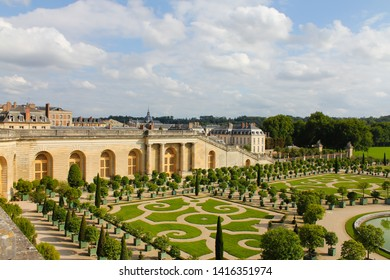 Versailles, France, August 23, 2011: Palace and park ensemble in France. Royal castle with beautiful gardens and fountains in sunny summer weather