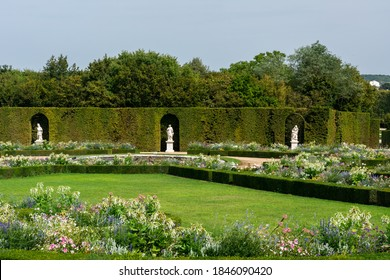 Versailles, France - August 28, 2019 : Panoramic of North Parterre in Versailles Gardens with statues, vases and trimmed bushes.