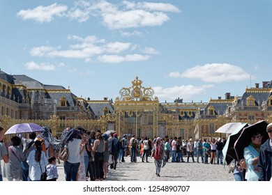 Versailles, France - august 6 2017 : crowd of people waiting at the entrance of the palace of Versailles.