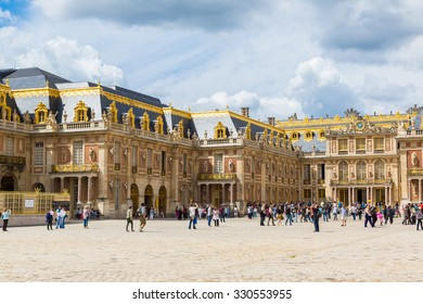 VERSAILLES, FRANCE - August 7, 2014: Outside view of Famous palace Versailles. The Palace Versailles was a royal chateau on August 7, 2014, France.