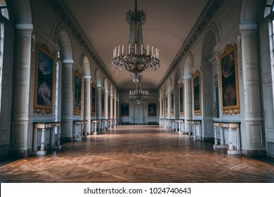 VERSAILLES, FRANCE - JANUARY 28, 2018: Big hallway with candelabra in Versailles, France