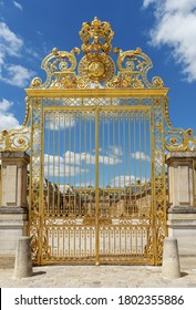 Versailles, France - July 07 2020: Golden ornate gate of Chateau de Versailles with blue sky in the background - Versailles, France