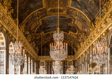 VERSAILLES, FRANCE - June 10, 2018:  Palace of Versailles crystal glass chandeliers in the Hall of Mirrors.