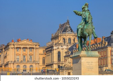 Versailles, France - March 1 2017 :  Equestrian statue of Louis XIV and the palace