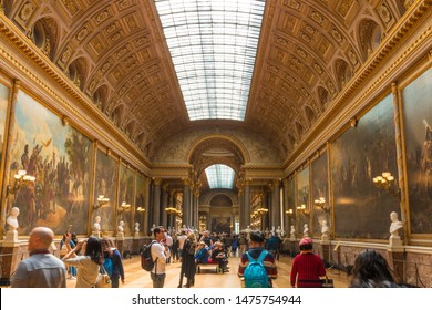Versailles, France - MAY 2019: Visitors admiring busts and the vast paintings depicting the French military successes in the Gallery of Great Battles in the south wing of the Palace of Versailles.