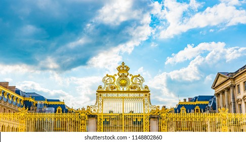 VERSAILLES, FRANCE - MAY 25, 2016: Golden gate of the Royal Palace of Versailles in France.