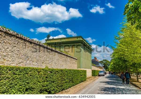 VERSAILLES, FRANCE - MAY 25, 2016: Street view in the Palace of Versailles, France. The Palace of Versailles is a royal chateau in Versailles, France.