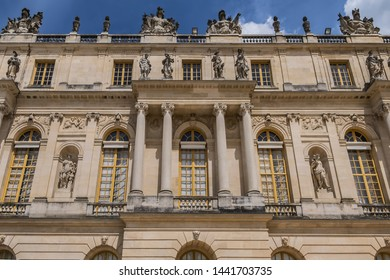 VERSAILLES, FRANCE - MAY 27, 2019: Architectural fragments of Chateau de Versailles (Palace of Versailles) near Paris: Facade facing the garden. Palace Versailles was a royal chateau.