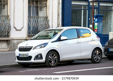 Versailles, France - September 15, 2019: White compact car Peugeot 108 in the city street.