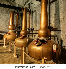Versailles, KY / USA - 11/9/2018: Three Vintage Column Stills Used in the Production of Bourbon at Woodford Reserve Distillery