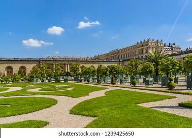 VERSAILLES, PARIS, FRANCE - MAY 18, 2014: Beautiful Orangerie Parterre in famous Versailles palace: palm trees, oleanders, pomegranate, eugenics and orange trees. Paris.